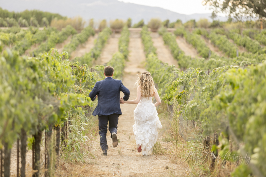 wedding-couple-in-vineyard-Sunstone-villa-winery-wedding