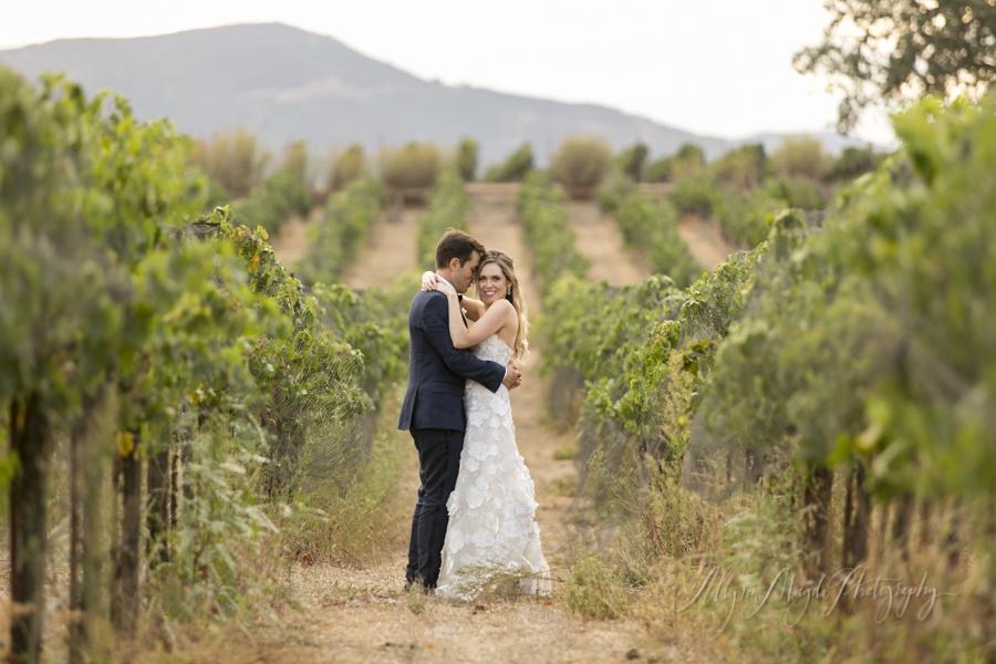 wedding-couple-in-vineyard-Sunstone-villa-winery-wedding